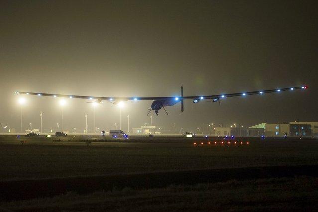 The Solar Impulse 2 plane is seen landing at Nanjing Lukou International Airport, Jiangsu province April 21, 2015. (Photo by Reuters/China Daily)