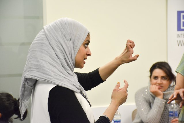 Egyptian-American community activist Rana Abdelhamid demonstrates how to hold one's fist for an attack punch during a self-defense workshop designed for Muslim women in Washington, DC, March 4, 2016 in this handout photo provided by Rawan Elbaba. (Photo by Rawan Elbaba/Reuters)