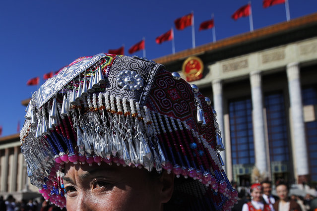 An ethnic minority delegate leaves the Great Hall of the People after attending the closing session of China's National People's Congress (NPC) in Beijing, Friday, March 15, 2019. (Photo by Andy Wong/AP Photo)