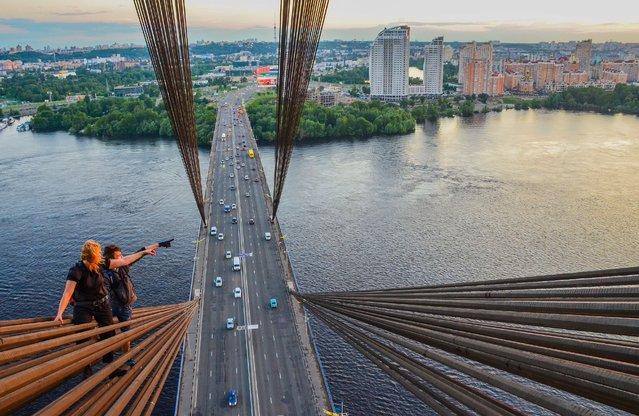 Two of Yaroslav Segeda's friends on the Moscow Bridge in Kiev. (Photo by Yaroslav Segeda/Solent News)