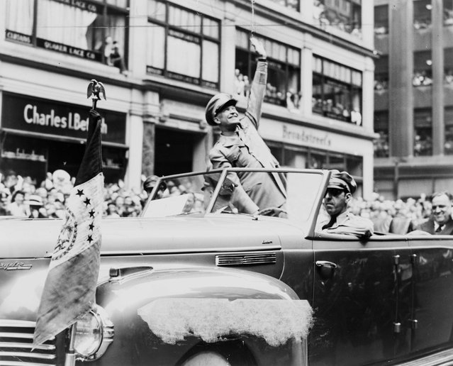 U.S. General Dwight D. Eisenhower waves to the crowd at a parade in the United States in 1945, in this handout photo provided by the United States Library of Congress. Seventy years ago, following the suicide of Nazi leader Adolf Hitler, Germany's head of state Karl Donitz signed his country's surrender to Allied forces in Reims, France on May 7, 1945 and in Berlin on May 8, 1945. (Photo by Fred Palumbo/Reuters/United States Library of Congress)