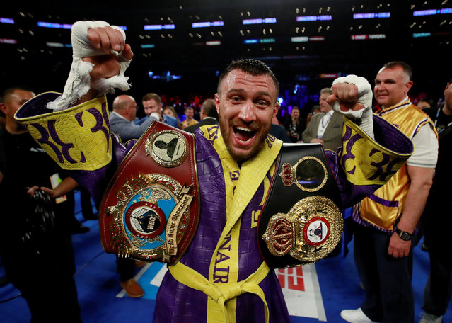 Vasiliy Lomachenko celebrates defending his WBA/WBO lightweight titles after knocking out Anthony Crolla at Staples Center on April 12, 2019 in Los Angeles, California. (Photo by Andrew Couldridge/Action Images via Reuters)