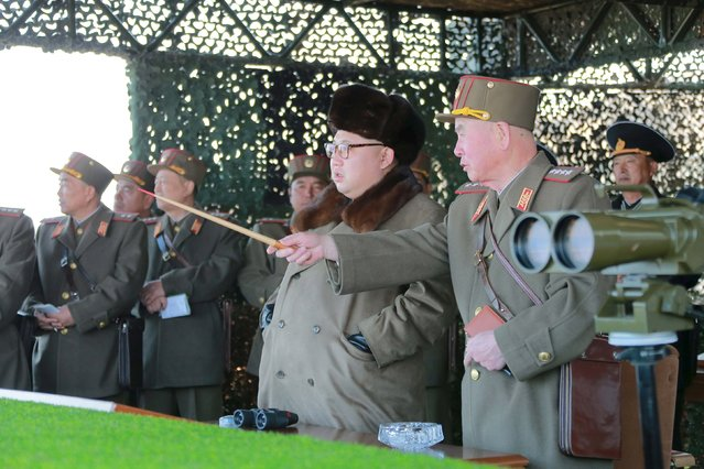 North Korean leader Kim Jong Un watches landing and anti-landing exercises being carried out by the Korean People's Army (KPA) at an unknown location, in this undated photo released by North Korea's Korean Central News Agency (KCNA) in Pyongyang on March 20, 2016. (Photo by Reuters/KCNA)