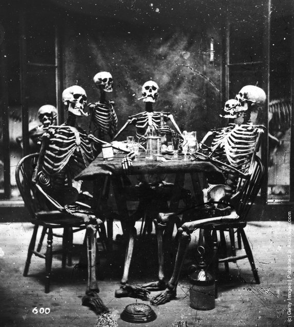 Six skeletons smoking around the dinner table