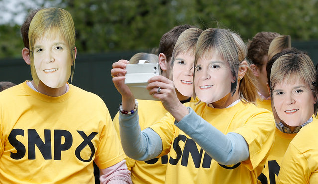 Conservative Party activists pose for a selfie whilst wearing face masks of Scottish National party leader Nicola Sturgeon during a stunt outside the Houses of Parliament, in central London, Britain, May 1, 2015. (Photo by Peter Nicholls/Reuters)
