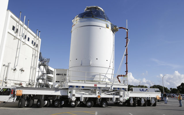 In this September 11, 2014 photo, NASA's Orion spacecraft, preparing for it's first flight, departs the Neil Armstrong Operations and Checkout Building on its way to the Payload Hazardous Servicing Facility at the Kennedy Space Center in Cape Canaveral, Fla. NASA's own inspector general said Monday, March 28, 2016, that Launch control software under development for NASA's deep-space exploration program is more than a year behind schedule and tens of millions of dollars over budget. (Photo by John Raoux/AP Photo)