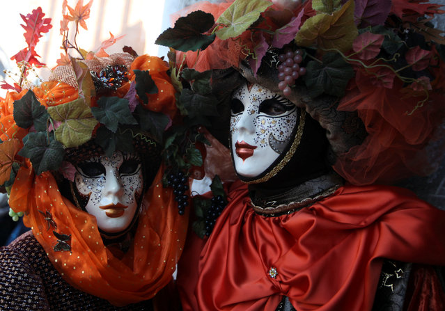 Masked revellers pose during the Carnival in Venice, Italy February 18, 2017. (Photo by Fabrizio Bensch/Reuters)