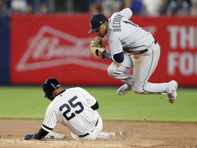 Seattle Mariners shortstop Tim Beckham (1) leaps after forcing out New York Yankees Gleyber Torres (25) after a grounder by Gio Urshela during the seventh inning of a baseball game Tuesday, May 7, 2019, in New York. (Photo by Kathy Willens/AP Photo)