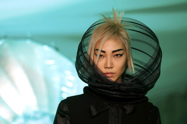 A model presents a creation by French designer Jean Paul Gaultier as part of his Fall/Winter 2014-2015 women's ready-to-wear collection show during Paris Fashion Week, on March 1, 2014. (Photo by Benoit Tessier /Reuters)