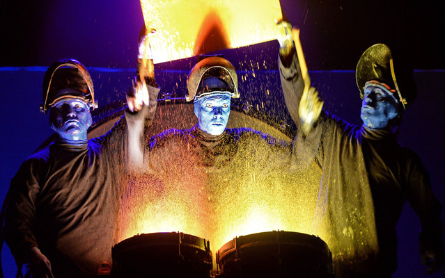 The Blue Man Group performs on stage during a media preview ahead of their show in Singapore on March 31, 2016. Blue Man Group was started by three friends in New York in 1991 as a way to celebrate the human spirit through music, science, art and theater. (Photo by Roslan Rahman/AFP Photo)