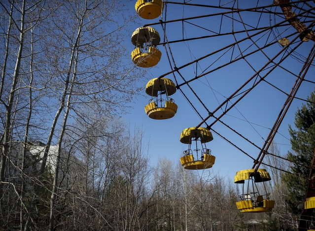 A ferris wheel is seen in the abandoned city of Pripyat near the Chernobyl nuclear power plant in Ukraine on March 28, 2016. (Photo by Gleb Garanich/Reuters)