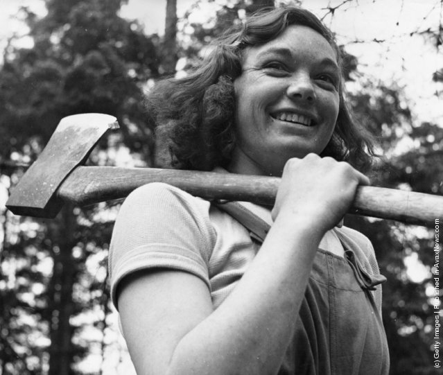 1942: Miss Cicely Clark of The Women's Timber Corps at work in a timber camp in Suffolk as part of the war effort