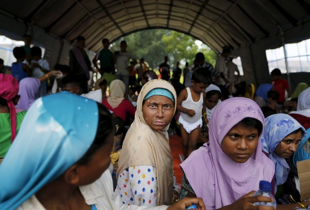 Nurul Haba (C), a Rohingya migrant who arrived in Indonesia by boat, sits inside a temporary shelter while waiting for medical treatment in Kuala Langsa, in Indonesia's Aceh Province May 16, 2015. (Photo by Reuters/Beawiharta)