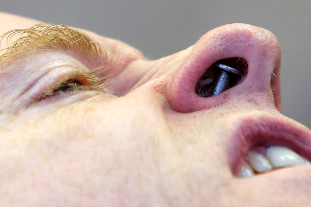 Performer Albert Cadabra displays a nail hammered into his nose at Ripley's Believe It or Not! Times Square Odditorium during celebrations for World Sword Swallower's Day in Manhattan, New York, U.S., February 25, 2017. (Photo by Andrew Kelly/Reuters)