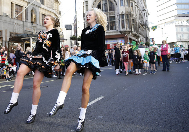 Dancers perform at the St Patrick's Day parade in central London March 16, 2014. (Photo by Olivia Harris/Reuters)