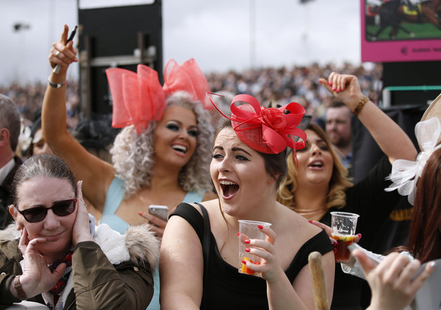 Racegoers react near the end of the 2.15 The Imagine Cruising First in the Frame Top Novices' Hurdle Race on Ladies Day of the Crabbie's Grand National Festival at Aintree Racecourse on April 8, 2016 in Liverpool, England. (Photo by Andrew Boyers/Reuters/Livepic)
