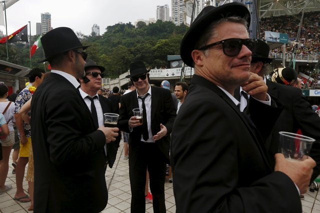 Rugby Union, Hong Kong Sevens, Hong Kong Stadium on April 9, 2016: Fans dressed in suits chat. (Photo by Bobby Yip/Reuters)