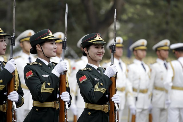 Female soldiers from the honour guard smile as they practice ahead of a welcoming ceremony for Australian Prime Minister Malcolm Turnbull (not in picture) outside the Great Hall of the People in Beijing, China, April 14, 2016. (Photo by Jason Lee/Reuters)