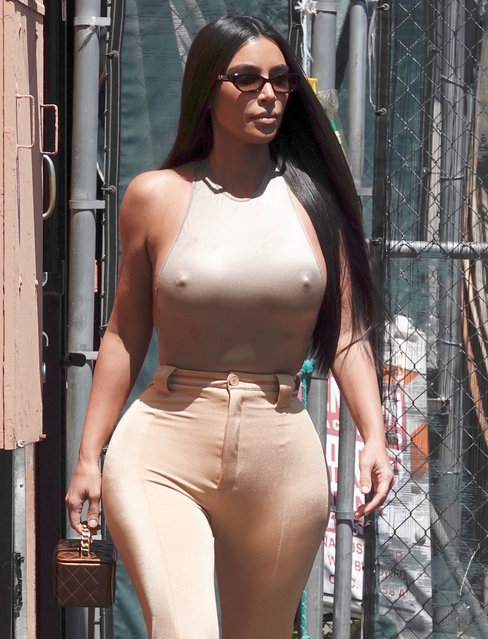 Reality TV star Kim Kardashian is seen leaving the back door of a restaurant in LA with her sister Khloe on June 7, 2019. (Photo by Lies Angeles/Splash News and Pictures)