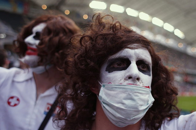 Rugby fans attend the first day of the three-day Hong Kong Sevens rugby tournament, as part of the Sevens World Series, in Hong Kong March 28, 2014. (Photo by Bobby Yip/Reuters)