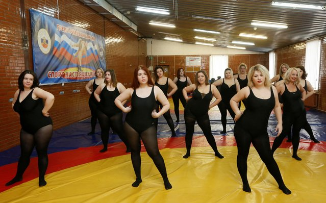 Models of the SibPlus Models agency and participants of the Miss Doughnut beauty competition take part in a training session in Krasnoyarsk, Siberia, Russia, March 4, 2017. (Photo by Ilya Naymushin/Reuters)