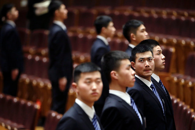 Security personnel wait for reporters and guests to leave the Great Hall of the People after the opening session of the Chinese People's Political Consultative Conference (CPPCC) in Beijing, China, March 3, 2017. (Photo by Jason Lee/Reuters)