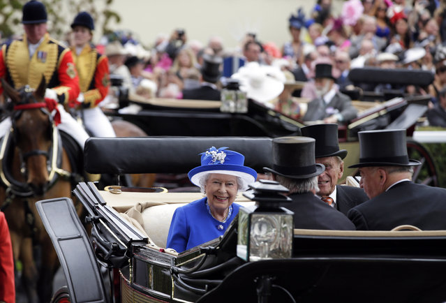 Britain's Queen Elizabeth II and Prince Philip, the Duke of Edinburgh arrive on the second day of Royal Ascot horse racing meet at Ascot, England, Wednesday, June 17, 2015. Royal Ascot is the annual five day horse race meeting that Britain's Queen Elizabeth II attends every day of the event. (AP Photo/Alastair Grant)
