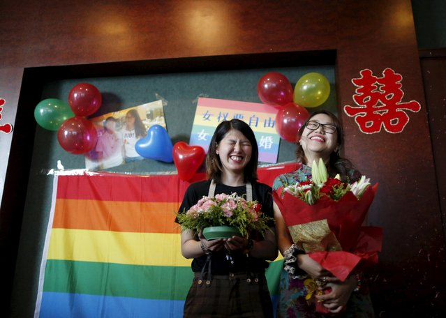 Li Tingting (L) and Teresa smile at their wedding reception in Beijing, China July 2, 2015. (Photo by Kim Kyung-Hoon/Reuters)