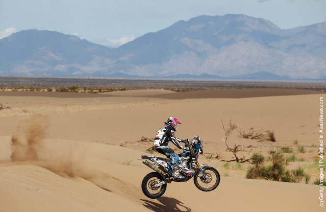 Vincent Guindani of France and Team Vizion Racing in action jumps a sand dune stage five of the 2012 Dakar Rally