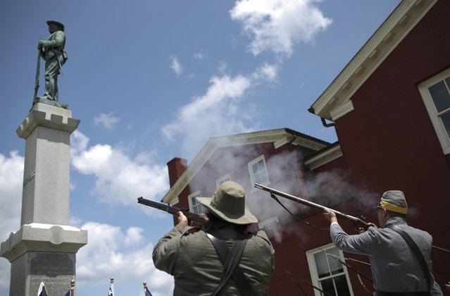 Members of the Sons of Confederate Veterans offer up a musket salute to Sgt. Tapley P. Mays during Confederate Medal of Honor ceremony in Pearisburg, Va., Saturday, July 11, 2015. Mays, an ensign in Company D of the 7th Virginia, was killed in battle carrying the Confederate battle flag. (Photo by John Roark/The Roanoke Times via AP Photo)