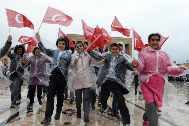 Children wave Turkish flags as they visit the mausoleum of Mustafa Kemal Ataturk, founder of modern Turkey, during a ceremony to mark the National Sovereignty and Children's Day in Ankara, on April 23, 2017. (Photo by Adem Altan/AFP Photo)