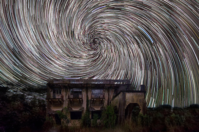 Star trails captured behind the Istana Woodneuk, one of the largest private residences in the late 19th century and early 20th century in Singapore. These astonishing images of night sky are captured by Singapore based photographer Justin Ng. The pictures were taken between November 2013 to January 2014. It show's star trail caused by the earth's rotation and also can be achieved by zooming the DSLR lens inward or outward in small steps using a dedicated motorized zooming device. (Photo by  Justin Ng/Barcroft Media)