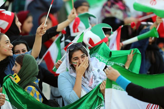 Female football fans show their support ahead of the FIFA World Cup Qualifier match between Iran and Cambodia at Azadi Stadium on October 10, 2019 in Tehran, Iran. (Photo by Amin M. Jamali/Getty Images)