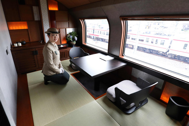 This picture taken on April 26, 2017 shows a crew member introducing the Shiki- Shima Suite of the Train Suite Shiki- Shima, operated by East Japan Railway, in Tokyo during a press preview. (Photo by AFP Photo/JIJI Press)