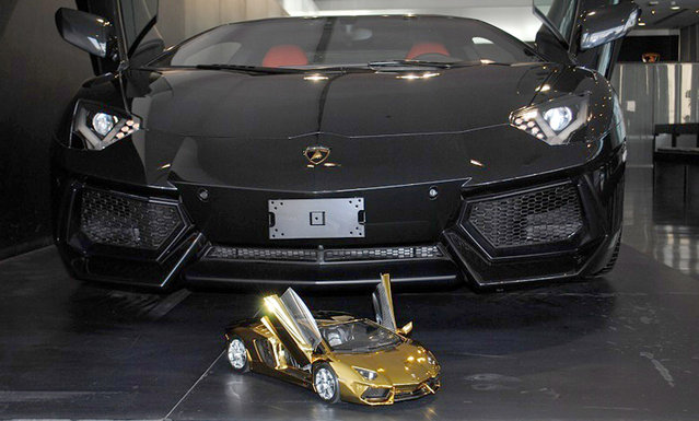 Engineer Robert Gülpen's replica model of a Lamborghini Aventador LP 700-4, in front of the real deal in the Lamborghini showroom in Dubai, UAE. (Photo by Robert Gulpen/Barcroft Media)