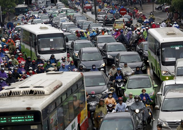 Commuters are seen during rush hour on a street in Hanoi, Vietnam, April 20, 2016. (Photo by Reuters/Kham)
