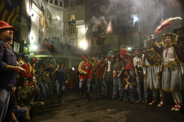 Performers during the Patum festival, in Berga, north of Barcelona, in the Catalonia region of Spain, May 29, 2016. Patum, a festival that dates to medieval times and plays out the struggle between good and evil,  also come to symbolize the far more modern political and social struggles of Spain – between right and left, church and state, the Spanish government in Madrid and Catalan secessionists. (Photo by Samuel Aranda/The New York Times)