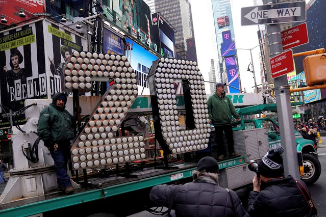 Workers unload the numerals 2 and 0 for News Year's Eve in Times Square in the Manhattan borough of New York City, New York, U.S., December 11, 2019. (Photo by Carlo Allegri/Reuters)