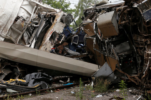 The wreckage of a passenger train is pictured after it crashed into the back of a freight train in the eastern Belgian municipality of Saint-Georges-Sur-Meuse, June 6, 2016. (Photo by Francois Lenoir/Reuters)