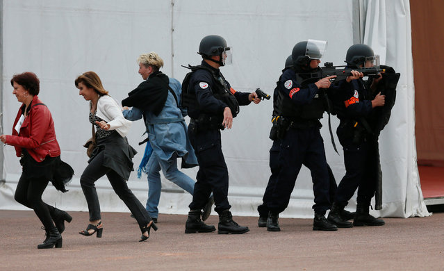 French police forces take part in a mock attack drill in the fan zone in the centre of Lyon, France, as part of security measures for the UEFA 2016 European Championship, June 7, 2016. (Photo by Robert Pratta/Reuters)