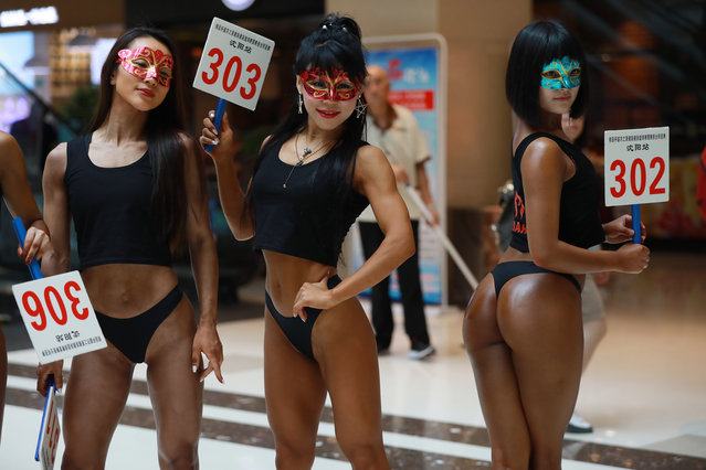 """In this picture taken on June 24, 2017 participants take part in the """"Women's Beautiful Buttock series"""" contest shopping mall in Shenyang, Liaoning province. Ladies from different parts of China gathered in Shenyang to show off their perfect curves during the competition. While it is unclear who ended up taking home 1st place, it looks like everyone had a good time regardless of whether or not they won the title. In November 2016, Brazil held a similar competition, Miss BumBum, which was attended by more than 10 million people. Erika Canela, a 24-year-old beauty from Bahia won the main title of the contest. (Photo by AFP Photo/Stringer)"""