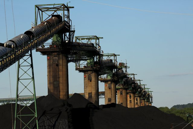 Coal is seen stacked at the base of coal loaders along the Ohio River in Ceredo, West Virginia, in this file photo taken May 18, 2014. In her 2008 bid for the White House, Hillary Clinton cast herself as a blue-collar Democrat who was unabashedly pro-coal, a stance that helped her beat opponent Barack Obama easily in  primaries in states that produced or were reliant on coal. (Photo by Robert Galbraith/Reuters)