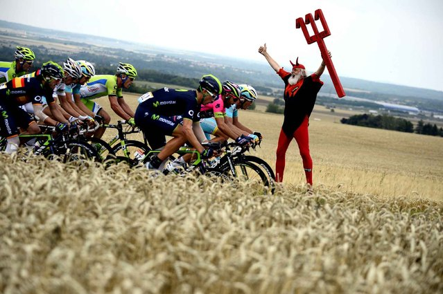 German fan Didi Senft known as El Diablo cheers as the pack rides past during the 234.5 km seventh stage of the 101st edition of the Tour de France cycling race on July 11, 2014 between Epernay and Nancy, northeastern France. (Photo by Lionel Bonaventure/AFP Photo)