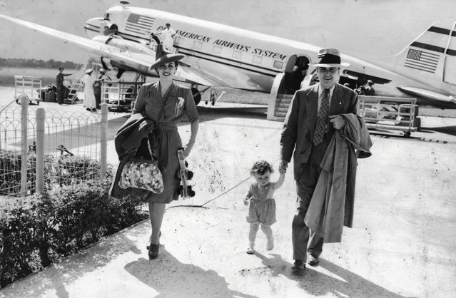 In this undated photo provided by Carolyn Chester, her parents, Edmund and Enna Chester and their daughter, Patricia, arrive in Cuba on a flight from Florida. When Fidel Castro's government began confiscating the property of thousands of U.S. citizens and companies in 1959, the Chesters lost an 80-acre farm and hundreds of thousands of dollars worth of stock. (Photo by AP Photo)