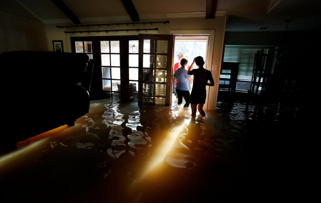 A family that wanted to remain anonymous moves belongings from their home flooded by Harvey in Houston, Texas August 31, 2017. (Photo by Rick Wilking/Reuters)