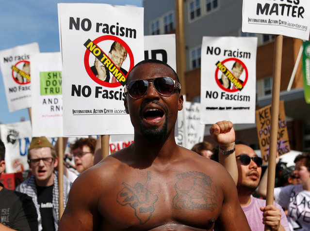 """A demonstrator yells during a march by various groups, including """"Black Lives Matter"""" and """"Shut Down Trump and the RNC"""", ahead of the Republican National Convention in Cleveland, Ohio, U.S. July 17, 2016. (Photo by Shannon Stapleton/Reuters)"""