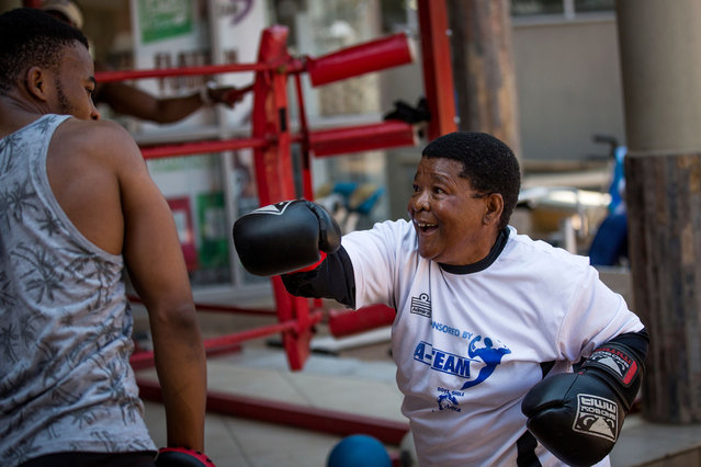 "The ""Boxing Gogos"" (Grannies) take part in a ""Boxing Gogos"" (Grannies) training session hosted by the A Team Gym in Cosmo City in Johannesburg on September 19, 2017. (Photo by Gulshan Khan/AFP Photo)"