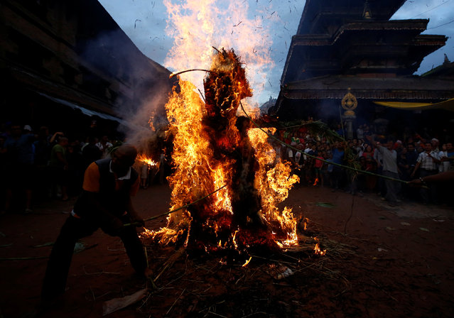 People set fire to an effigy of the demon Ghantakarna, to symbolize the destruction of evil, during the Ghantakarna festival at the ancient city of Bhaktapur, Nepal August 1, 2016. (Photo by Navesh Chitrakar/Reuters)