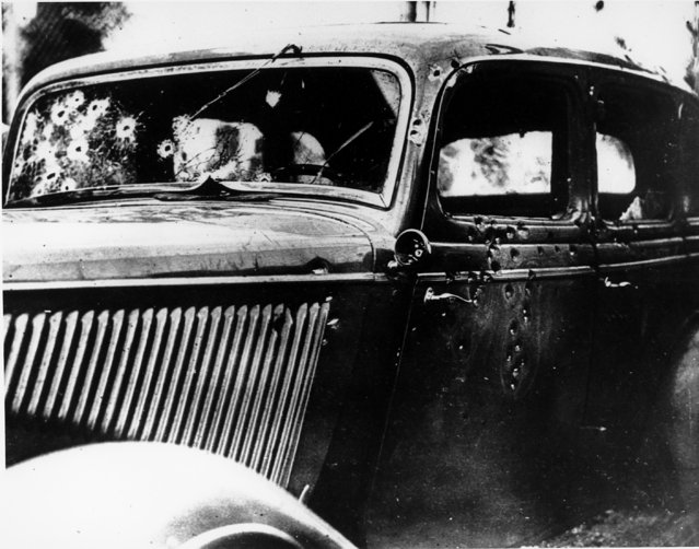 The bullet-riddled automobile in which the bandits, Clyde Barrow and Bonnie Parker, were trapped, shot and killed on a Louisiana road is seen May 24, 1934.  Officers waited for the desperadoes near Arcadia, La., and pumped 167 bullets into the car. (Photo by AP Photo)