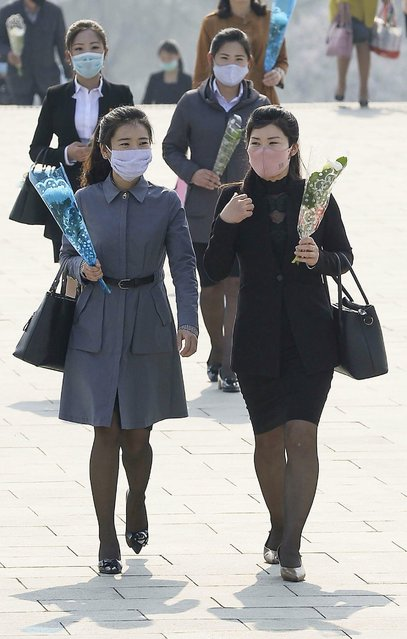 People visit the Mansu Hill to lay flowers to the bronze statues of late leaders Kim Il Sung and Kim Jong Il on the occasion of the 108th birth anniversary of Kim Il Sung in Pyongyang, North Korea Wednesday, April 15, 2020. (Photo by Alamy Live News)